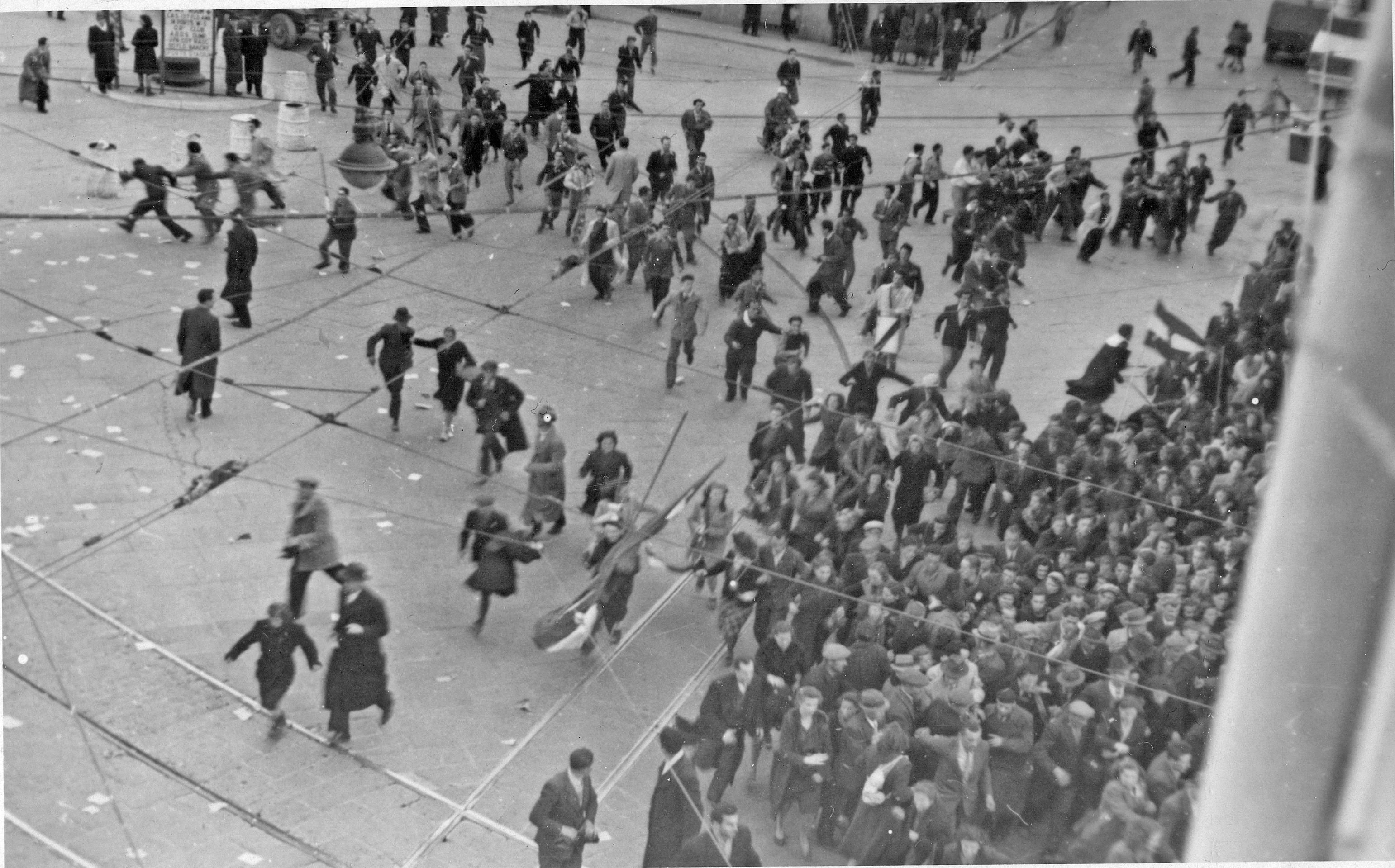 People running away from godzilla